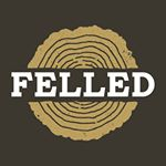 Felled: an urban lumber documentary film (logo of wood round cut)